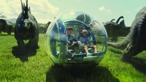 Nick Robinson and Ty Simpkins in a Jurassic World gyrosphere