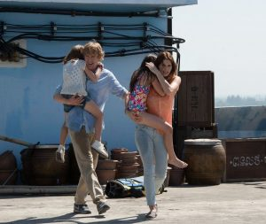 Owen Wilson and Lake Bell carry Sterling Jerins and Claire Geare in No Escape