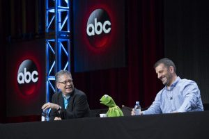 Bill Prady (l) and Bob Kushell (r) on a panel with Kermit the Frog
