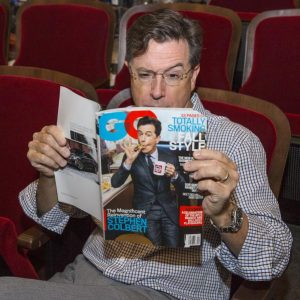 Colbert tweeted a picture of himself reading his GQ cover story.