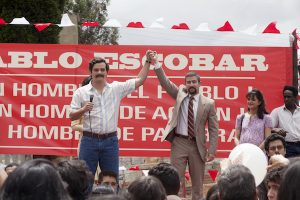 """WAGNER MOURA, JULIAN BUSTAMANTE and PAULINA GAITAN (right) star in NARCOS.  NARCOS S01E03 """"The Men of Always"""""""
