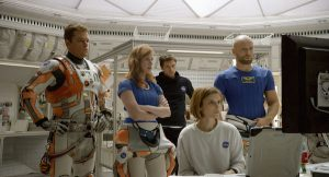 (from left) Matt Damon, Jessica Chastain, Sebastian Stan, Kate Mara, and Aksel Hennie portray the crewmembers of the fateful mission to Mars.