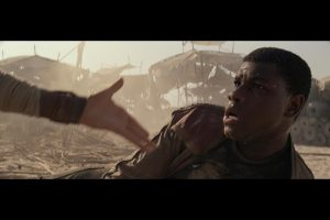 Finn (John Boyega) gets a helping hand in Star Wars: The Force Awakens