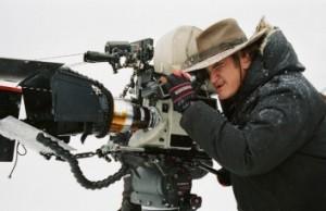 Tarantino looks through the 70mm camera.