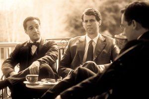 Walt (Thomas Ian Nicholas) and Roy Disney (John Heder) in a business meeting