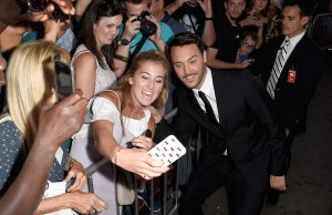Actor Jack Huston poses for a selfie with fans during the LA Premiere of Ben-Hur, at the TCL Chinese Theatre IMAX on August 16, 2016 in Hollywood, California.  (Photo by Frazer Harrison/Getty Images For Paramount Pictures)